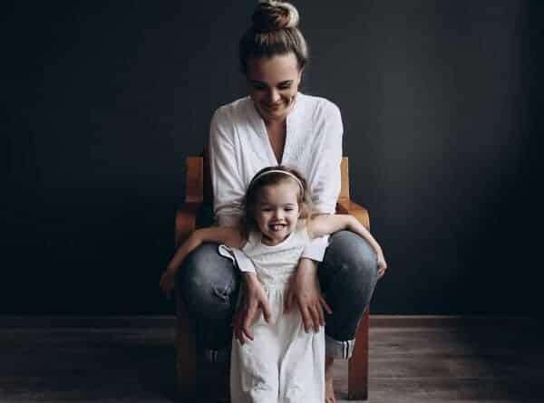 mother and daughter dark studio photoshoot