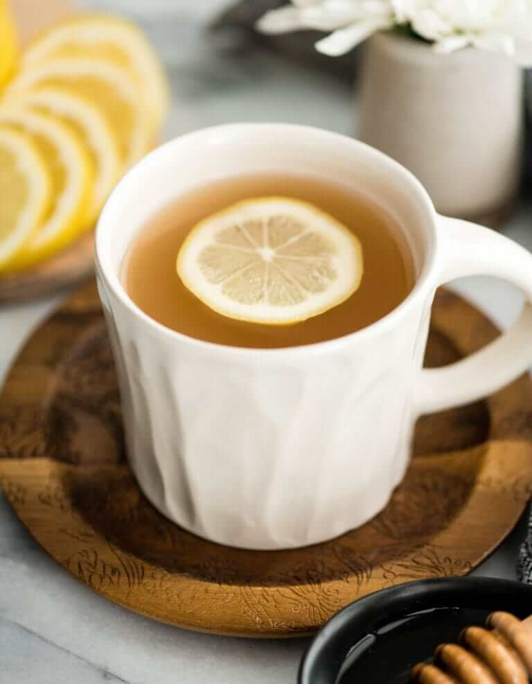 Apple Cider Vinegar tea with lemon slice