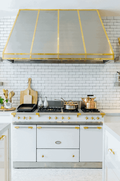 white kitchen cabinets with gold details