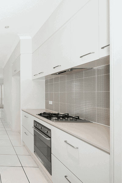 white kitchen cabinets with tiled backsplash
