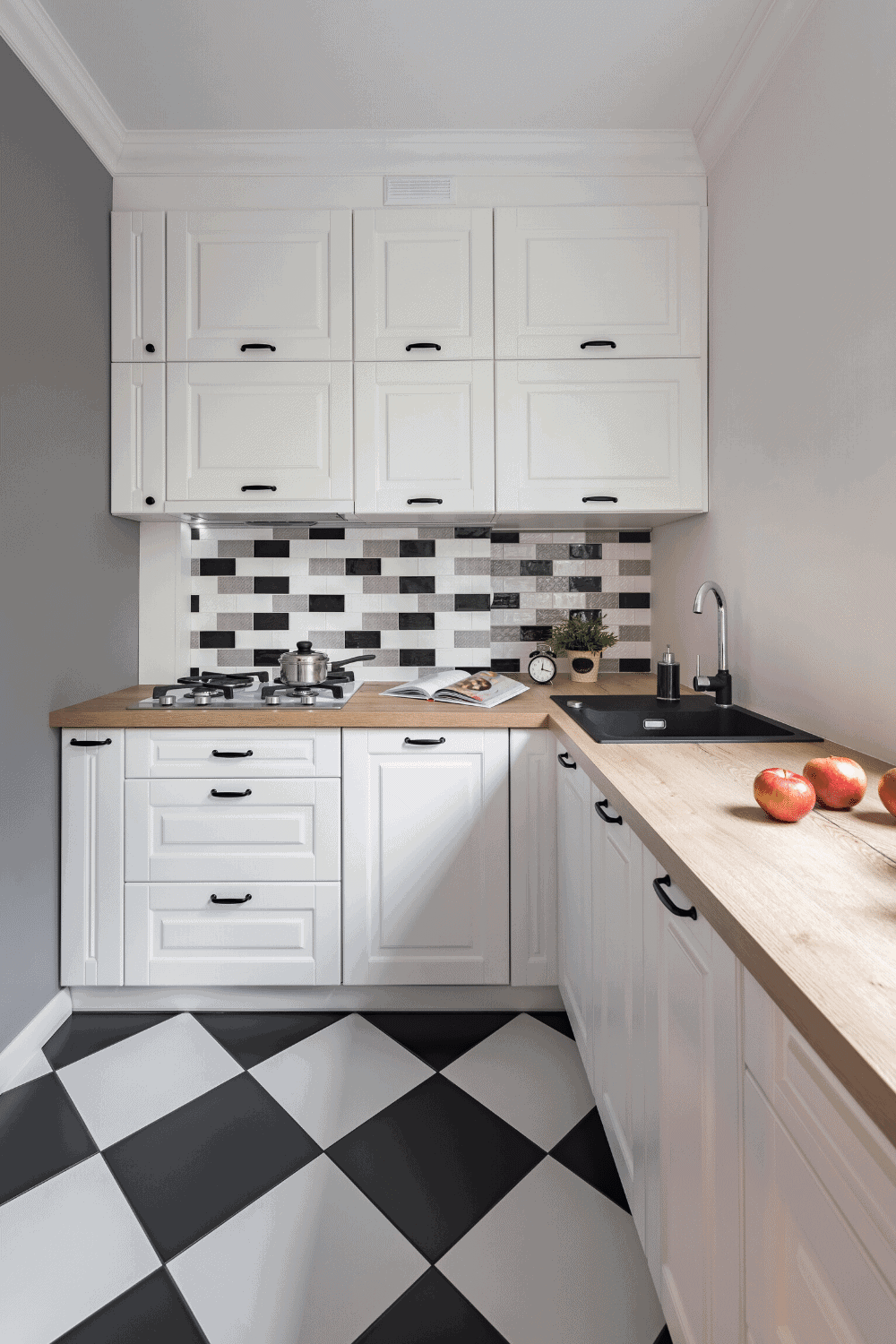 white kitchen cabinets with wooden countertops