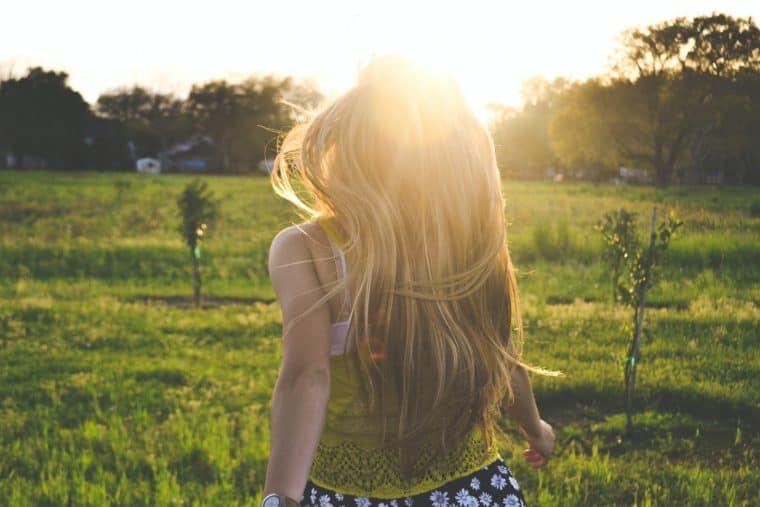 female walking in a field